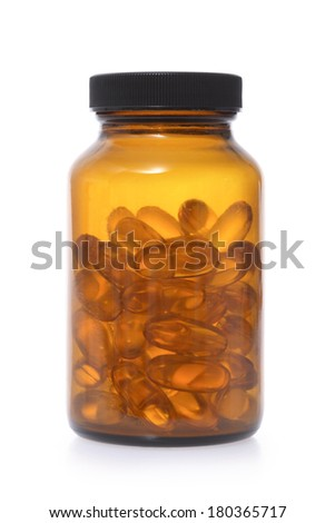 Colored glass pill bottle with vitamin pills on white background - stock photo