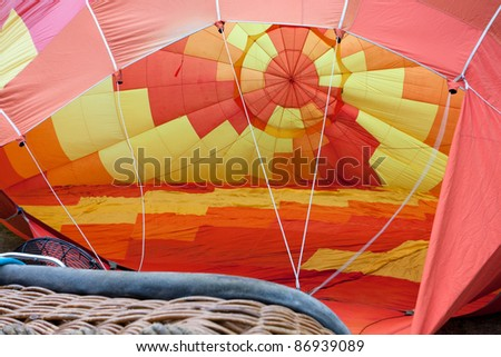 Colored hot air balloon inflated before the departure. - stock photo