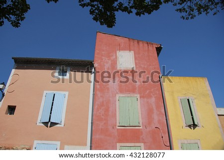 Colored houses in the village of Roussillon, France - stock photo