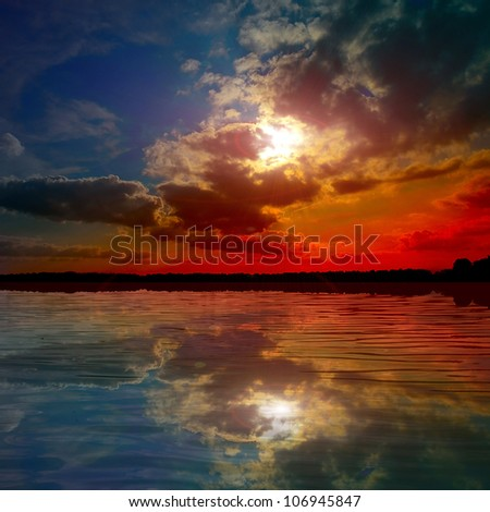 colored lake at the sunset - stock photo