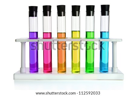 Colored liquids in six test tubes isolated over white background - stock photo
