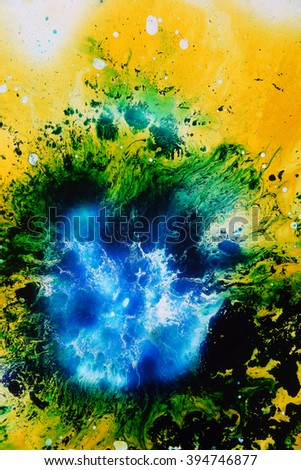 Colored liquids mixed together in fluid creating colorful abstract painting - stock photo