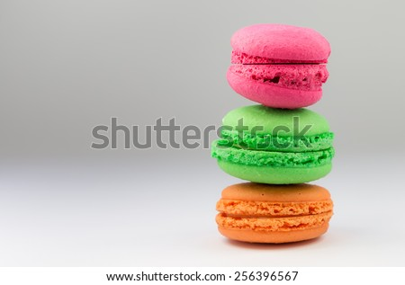 Colored Macaroon Biscuit, Silver Background - stock photo