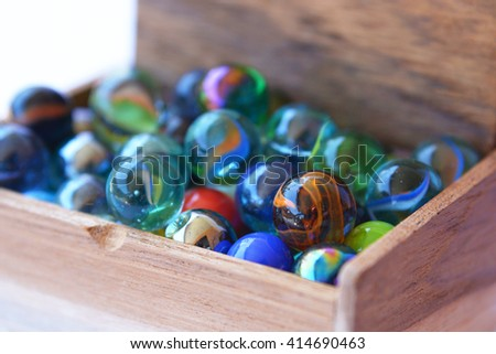 Colored marbles in a box - stock photo