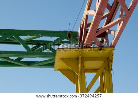 Colored metal construction on blue sky background - stock photo