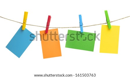 colored notes hanging from a rope on a white background - stock photo