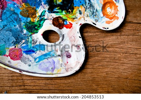 Colored Palette, acrylic paint, Concept and Idea for Art Education on Wood Table Desk Background, Rustic Style. - stock photo