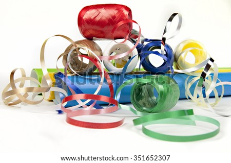 colored papers and ribbons on white - stock photo