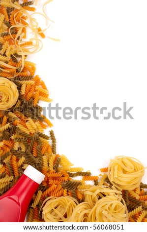 colored pasta with a bottle of ketchup - stock photo