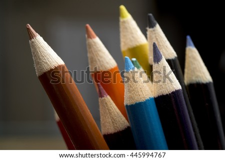 colored pastels on black  - stock photo