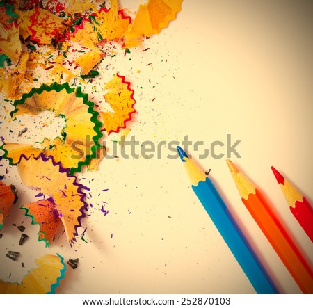 colored pencils and shavings on white background with copy space. instagram image retro style - stock photo
