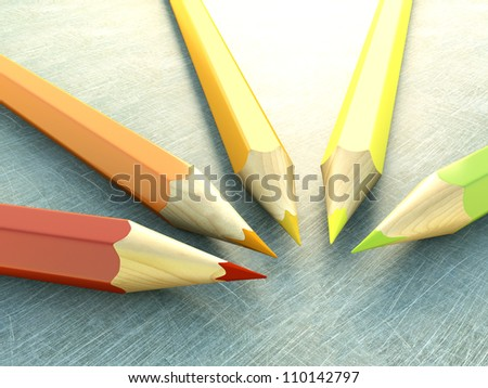 colored pencils arranged on floor scratches - stock photo