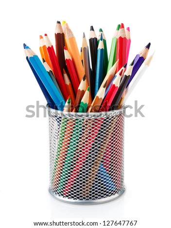 colored pencils in a pencil cup on a white background - stock photo