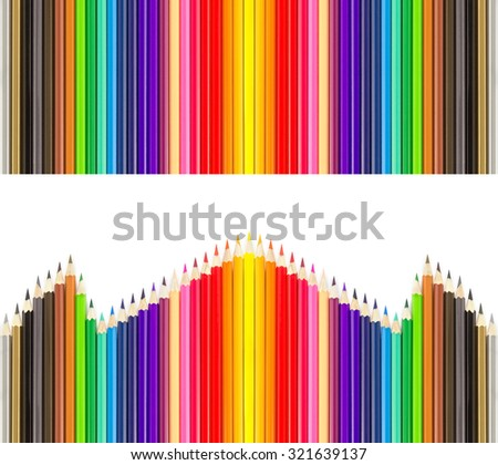 Colored pencils in rows on white background - stock photo