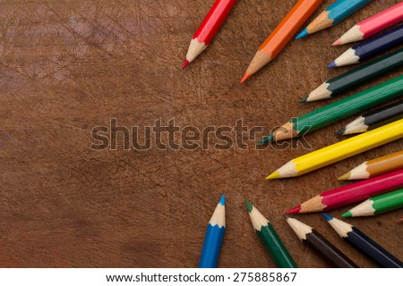 Colored Pencils, isolated on wood background, may use as banner or slide - stock photo