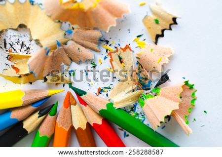 colored pencils lying on a sheet of white paper - stock photo
