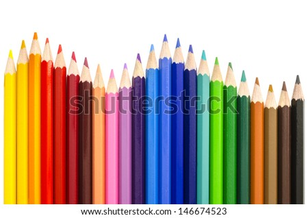 Colored pencils making a wave. With copyspace - stock photo