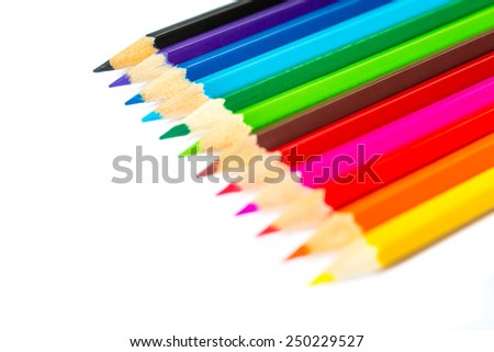 Colored pencils on an isolated background. Focus on the blue pencil - stock photo