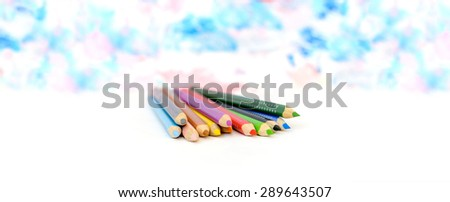 Colored pencils on painted blur background  - stock photo