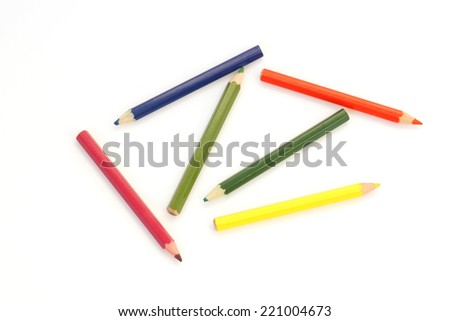 Colored pencils on white paper                                - stock photo