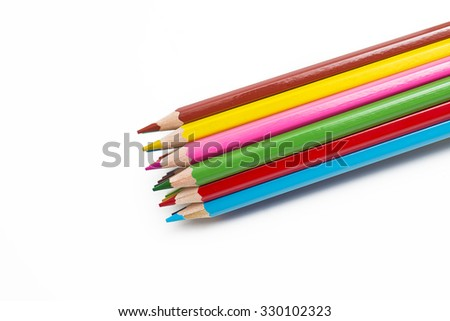 Colored pencils together on white background - stock photo
