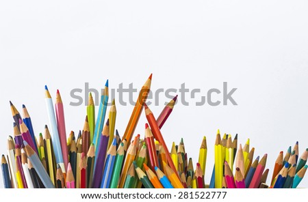 colored pencils vertical placed randomly in a container, pencils used and consumed, photo front of, natural light on a white background - stock photo
