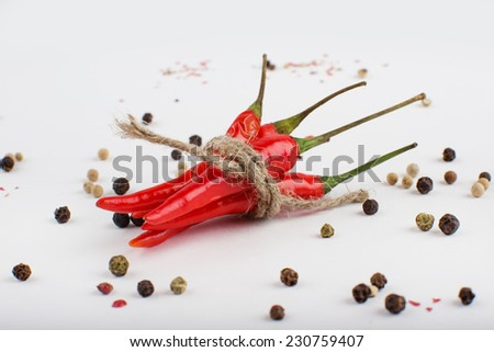 Colored Peppers Mix with red chili pepper on a white background. Pepper spices - stock photo