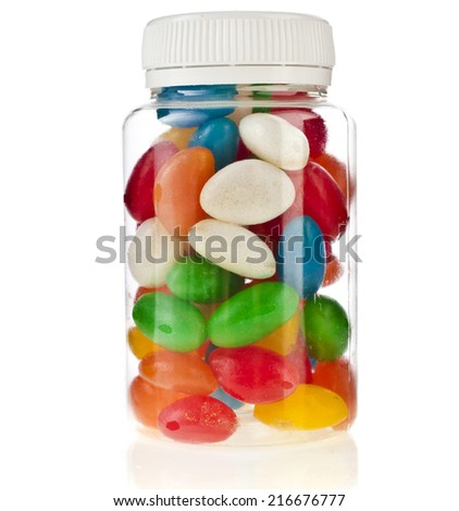 Colored Pills in the plastic bottle  isolation on a white background - stock photo