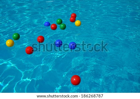 Colored plastic balls in a swimming pool. Transparent turquoise clear water  - stock photo