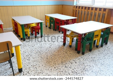 colored plastic chairs and small tables of school refectory for children - stock photo