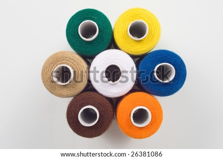 colored sewing spools in hexagon shape - stock photo