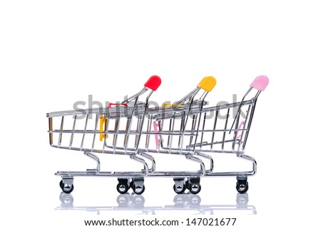 Colored shopping carts isolated on the white background - stock photo