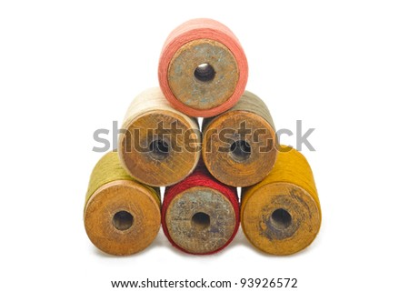 Colored spools of cotton thread - stock photo