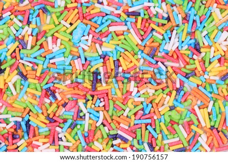 Colored sprinkles. To be used as background. - stock photo