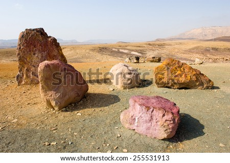 Colored stones in the Makhtesh ramon crater in the negev desert - stock photo