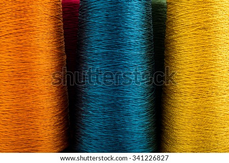 colored thread spools of thread large class, textiles, background larger image - stock photo