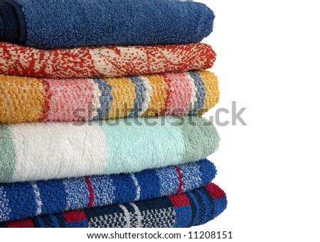 colored towels on white background - stock photo
