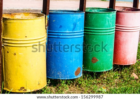 colored trash bins in a park - stock photo