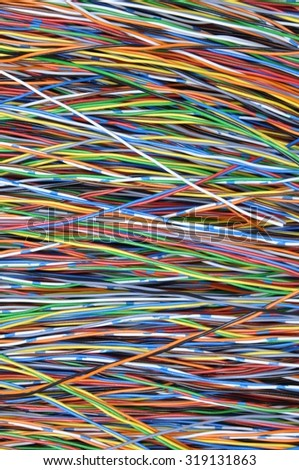 Colored wires in global telecommunications networks as background - stock photo