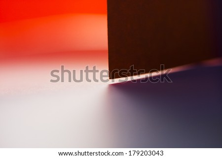 Colorful abstract composition with paper, lights and shadows - stock photo