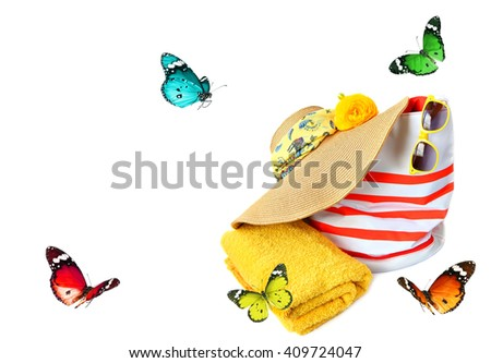 Colorful accessories for summer beach and butterflies flying. Vacation theme - stock photo