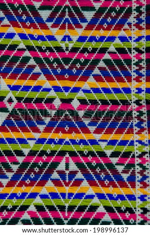 Colorful african peruvian style ornament surface close up. - stock photo