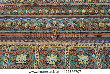 Colorful aged flower ceramic tile decoration at buddhist temple , Wat Pho Bangkok, Thailand - stock photo