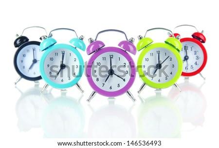 Colorful alarm clock isolated on white - stock photo