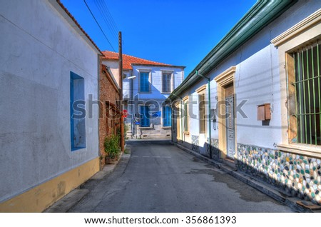 Colorful alley in Larnaca, Cyprus in HDR on a clear blue sky - stock photo