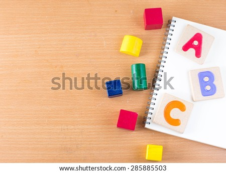 """Colorful alphabet letters ,""""abc"""" and the book - stock photo"""