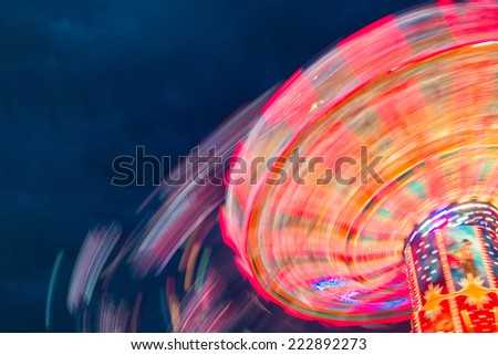 Colorful amusement park with night lights - stock photo
