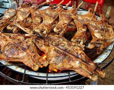 colorful and variety of street food in downtown Bangkok and cities in everyday life in Thailand. Here grilled chickens. - stock photo