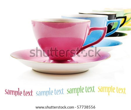 Colorful antique teacups on a white background with space for text - stock photo