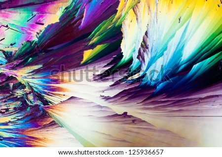 Colorful apearence of crystals of benzoic acid, a food preserving additive, in polarized light. - stock photo